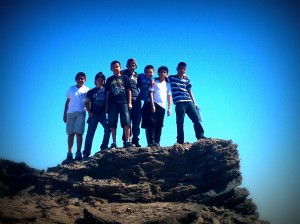 A group of Nativity sixth-grade boys poses atop one of the pinnacles of the obsidian buttes in Anza-Borrego Desert on a recent trip there.