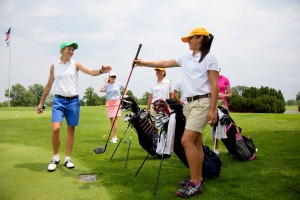 Evans Scholars caddie Christina Abarca (NPA '12) learns the ins and outs of the caddying profession this summer at the Onwentsia Club in Lake Forest, Illinois.