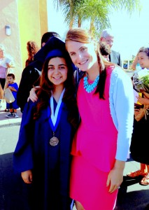 Tania, pictured here at her June 2013 graduation, with her mentor and teacher and author of this story, Ms. Kelly Determan.